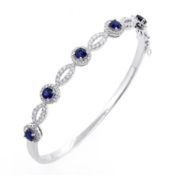 0.93 Cts Sapphire and Diamond Halo Bracelet set in 18K white gold