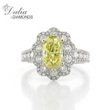 3.32 Cts Oval Cut Yellow Diamond Ring with Flower Shape halo set in 18K White Gold