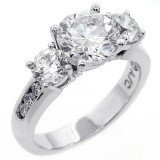Three stone round cut diamond engagement ring set in 14 K white gold