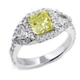 Fancy Yellow Cushion Cut Three Stone ring set in 18K White Gold