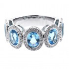 0.57CTS DIAMOND RING WITH OVAL BLUE GEM STONES OF 4.20 CTS SET IN 14K WHITE GOLD