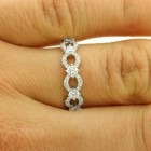 0.59 Cts Round Cut Diamond Wedding Band set in 18 K White Gold