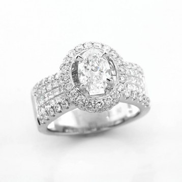 Pave and Invisible Setting 3.15 Ctw Oval Cut Diamond Ring with Halo Set in 18K White Gold