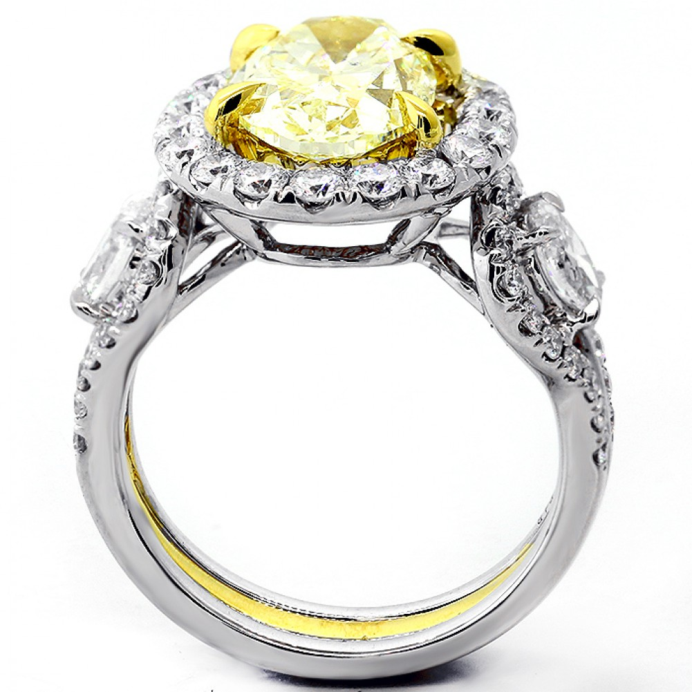 4 73 cts fansy yellow oval cut engagement ring set in 18k